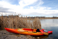 Kayak on the shore of a marsh, North Dakota