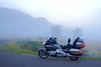 Gold Wing motorcycle in the fog, North Dakota badlands
