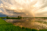 Storm Clouds and Rainbow over a North Dakota Marsh
